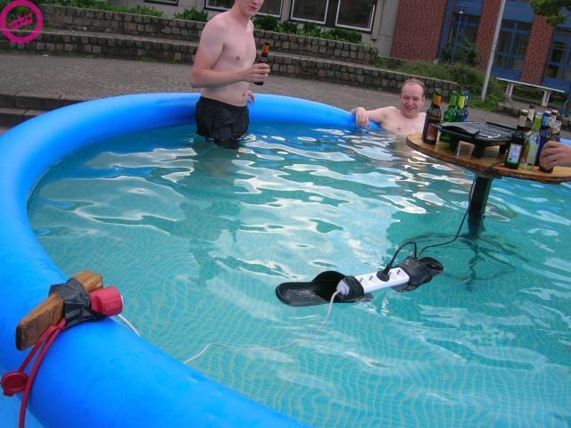 Flip Flop Holding Electrical Cord in Pool